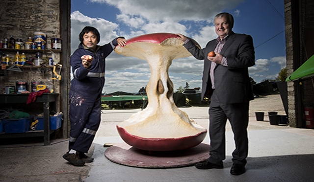 Artist Shiro Masuyama and Colum Best, Dunclug Partnership inspect part of the 'Five Apples' sculpture launching June 2015