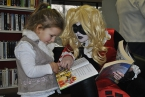 Comic villainess Harley Quinn is pictured with a young fan at the launch of the first Enniskillen Comic Fest which is supported by the Arts Council of Northern Ireland. Photograph credit Lauren Trimble