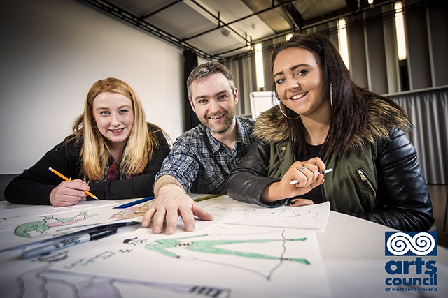 In celebration of Care Day NI, the MAC, has launched a new initiative, Arts Award, enabling 60 disadvantaged young people to achieve an accredited arts qualification. Pictured with Danny McLaughlin, Revolve Comics, are Ashleen Annett and Jemma Monteith.