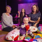 Pictured at the launch concert are Ciara Burnell and her baby Lucy Burnell-McAleavey, with musicians Kristine Donnan (piano) and Laura McFall (Voice).