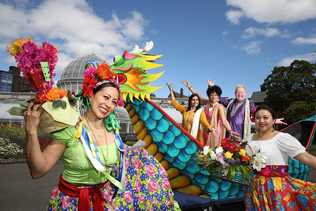 Mexican dancers Mayte Segura and Denise Navarrete with hosts U105's Carolyn Stewart and UTV's Julian Simmons and Nisha Tandon, Executive Director of ArtsEkta and founder of the Belfast Mela in Mela's stunning Chinese Dragon Boat at Botanic Gardens.
