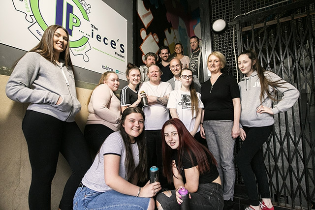 Pictured are Séamus Mullen (PHA), Lorraine Calderwood (Arts Council), Chris Deconink (Extern), artists Glenn Black and Ken Maze (Blaze FX), with some of the staff and young people involved in Extern's arts project funded through the ARTiculate Programme