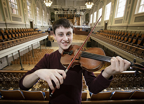 239 year old violin is presented to Ulster Youth Orchestra Leader, Samuel Kane