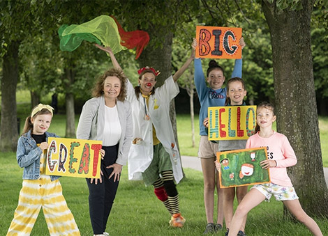 Communities Minister & children from Scoil an Droichid join in Arts Care's SAY A GREAT BIG HELLO